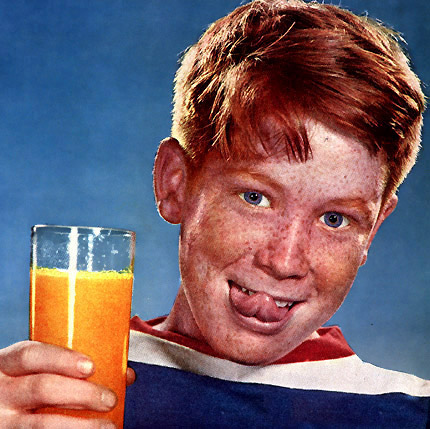 Redheaded kid with orange juice