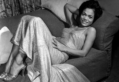 Eartha Kitt reclining…time for some action…