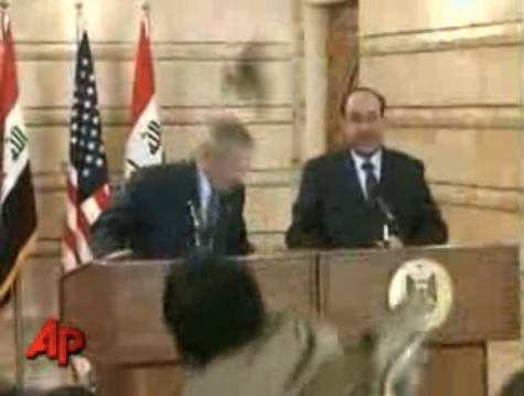 Iraqi Journalist Throws Shoe At Bush