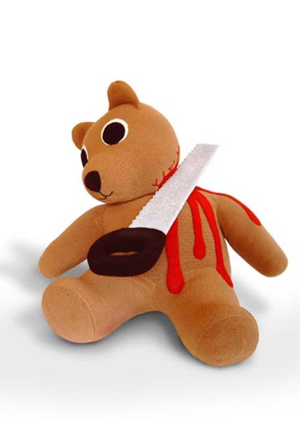 Teddy bear with its head getting sawed off