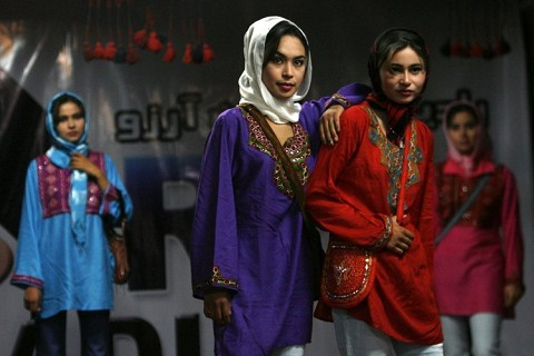 Afghan models do the catwalk.